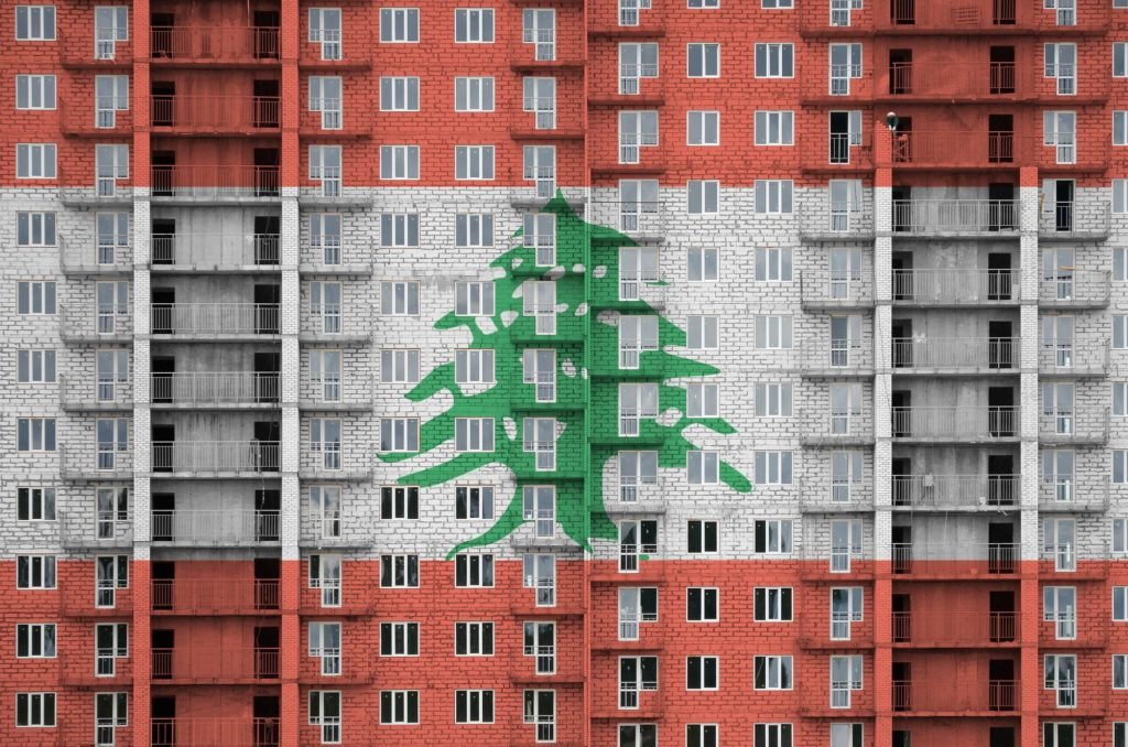 Lebanon flag depicted in paint colors on multi-storey residental building under construction